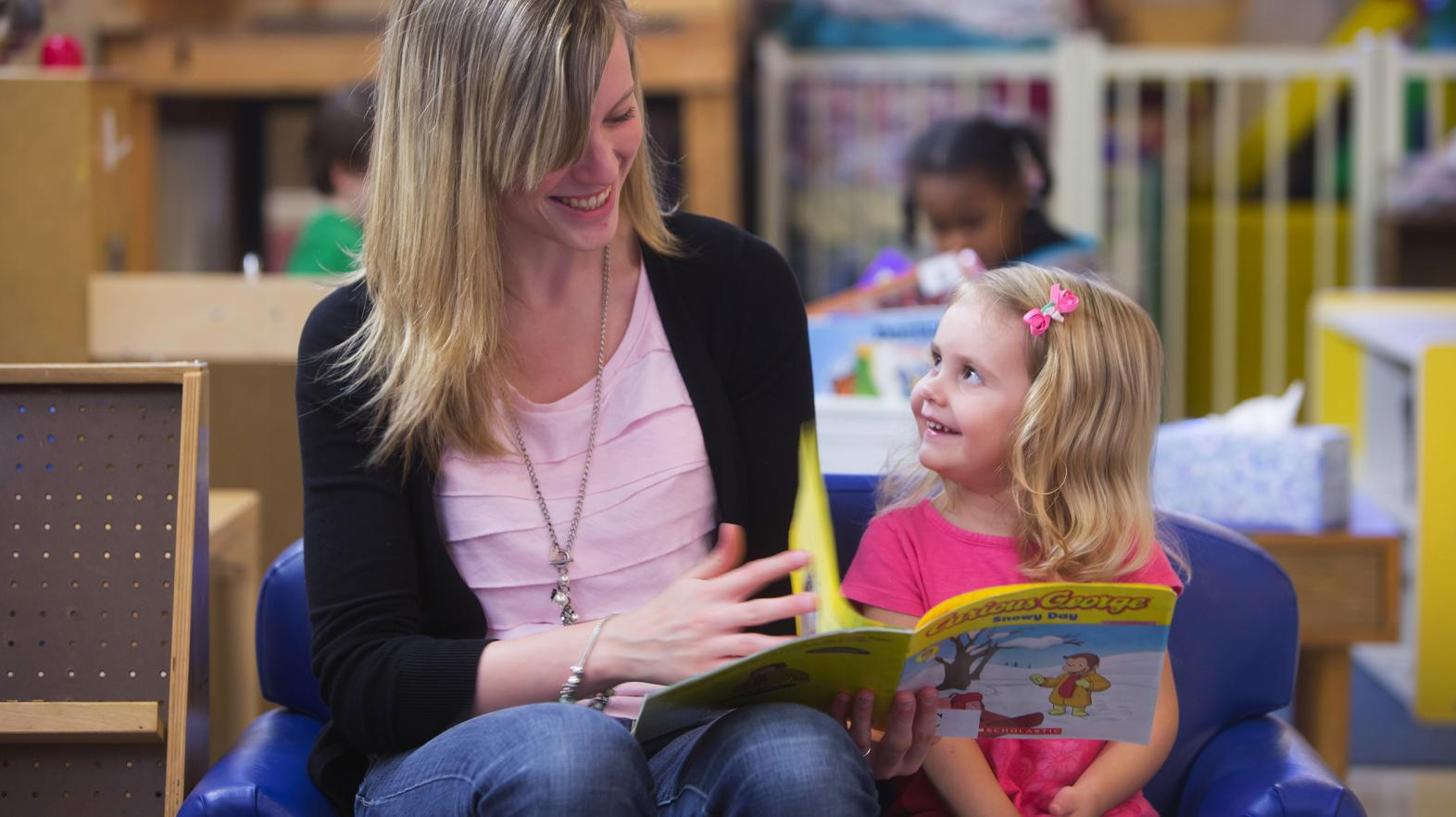 Teacher in the Child Development Center reading to a child