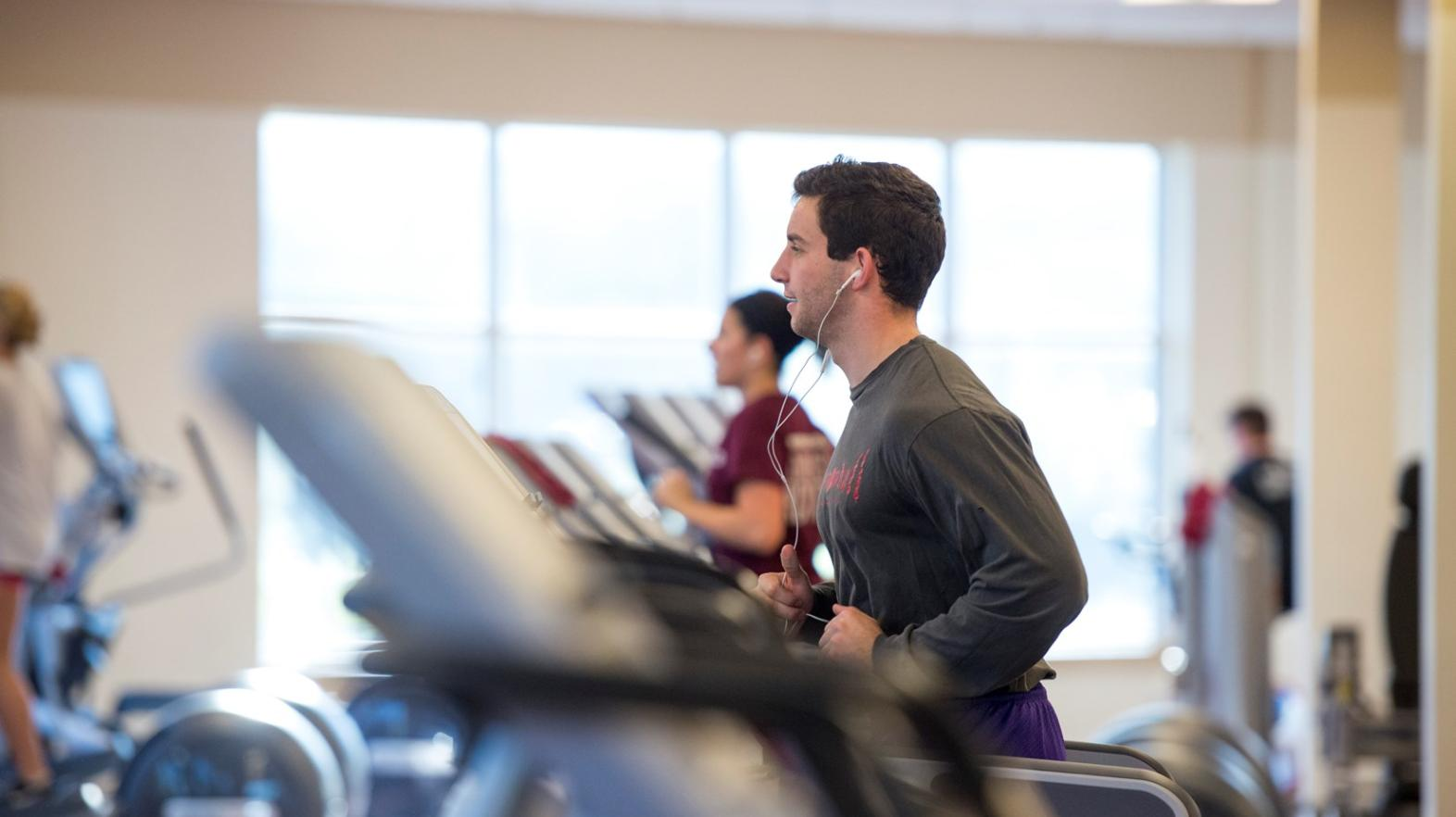 Male student works out in the Wellness Center within the Springfield College Wellness & Recreation Complex