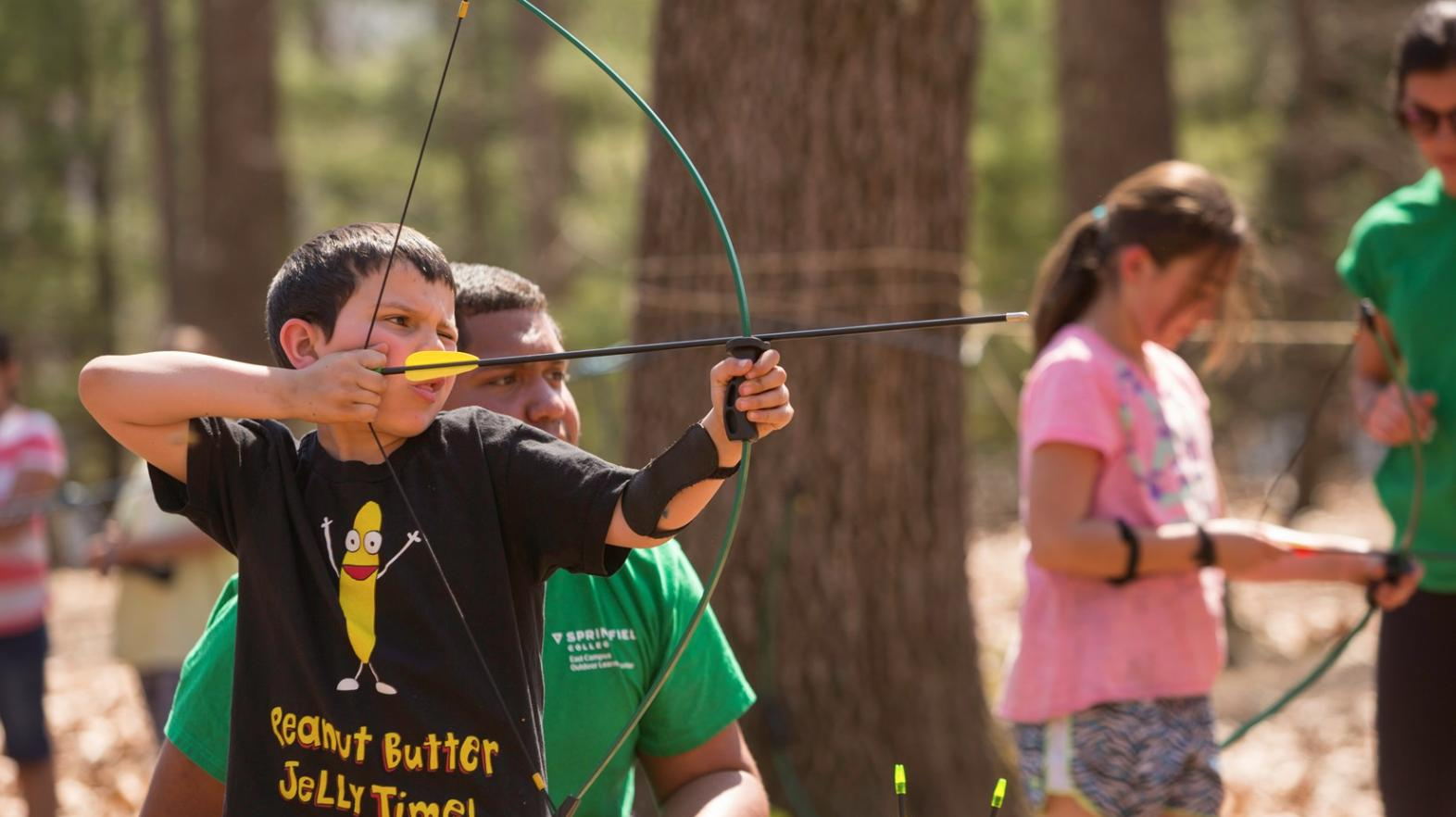 Young boy practices archery as part of Spring Explorers at East Campus