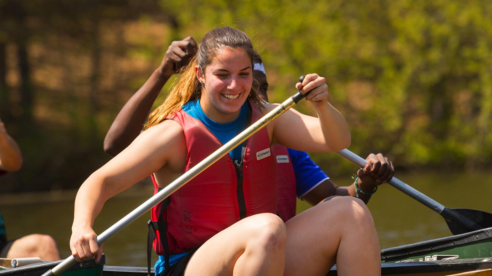 Student canoeing on Lake Massasoit at East Campus
