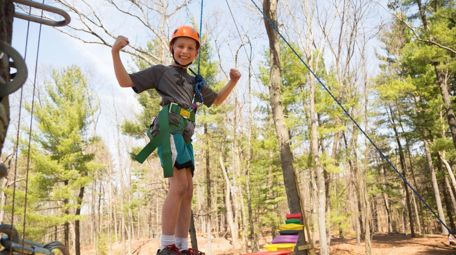Young child on the challenge course at East Campus