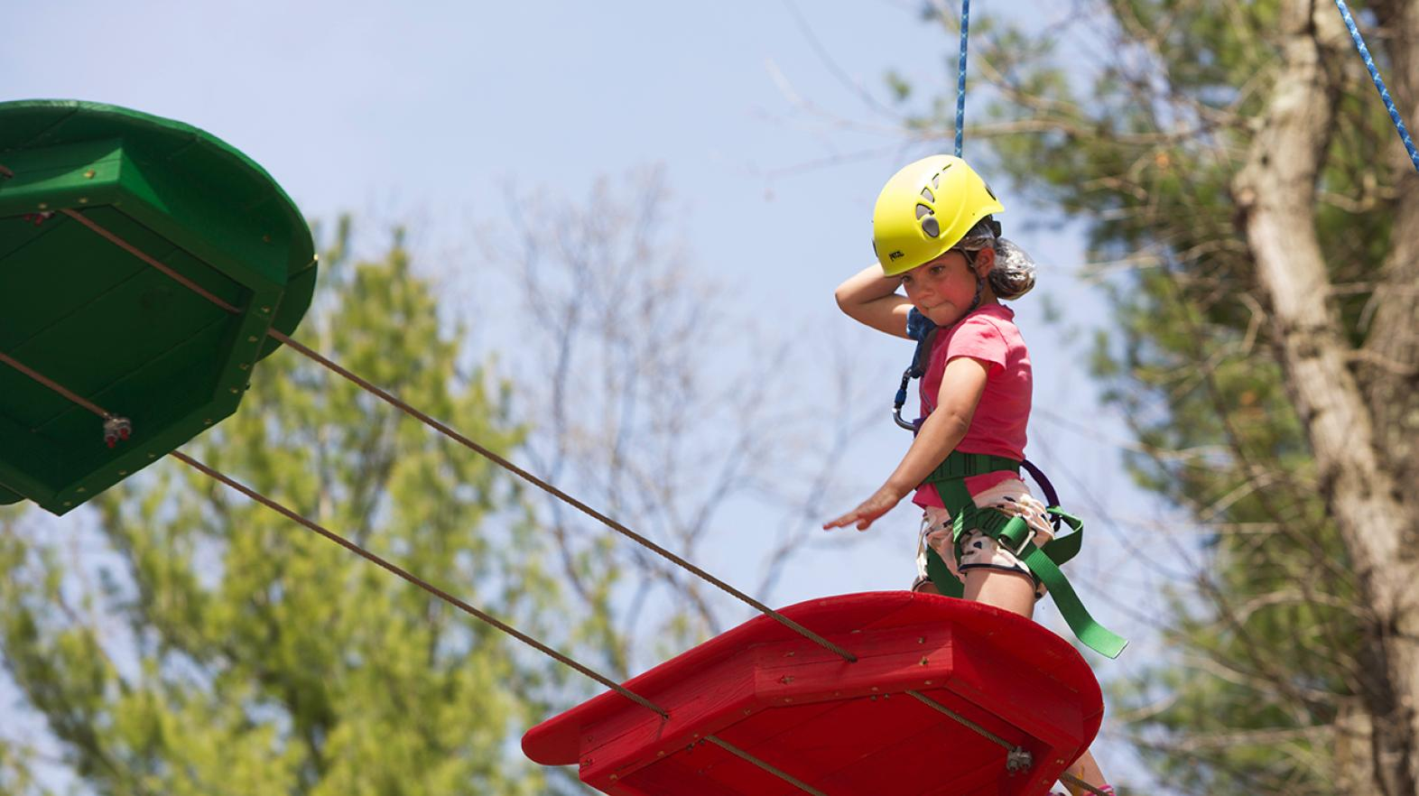 Young girl focusing on the challenge course at East Campus