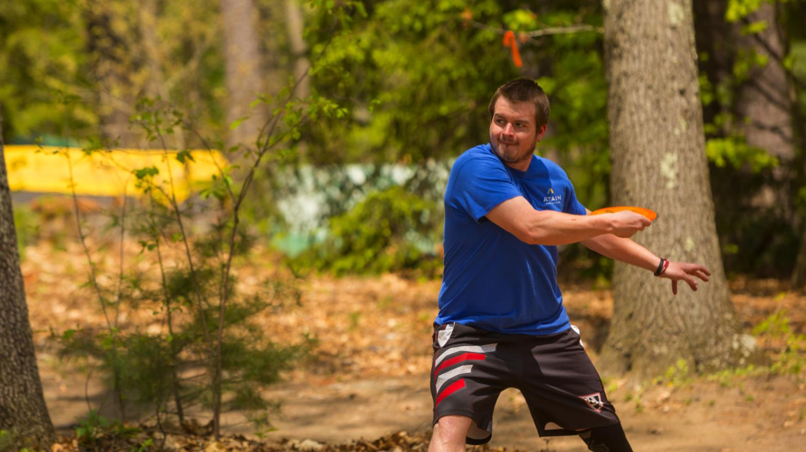 Springfield College student playing disc golf at East Campus
