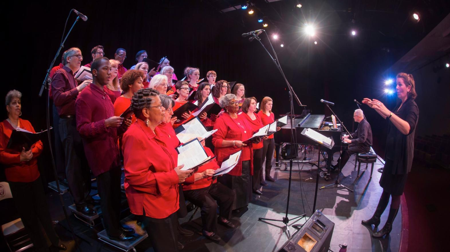Students and community members sing at the Springfield College holiday concert