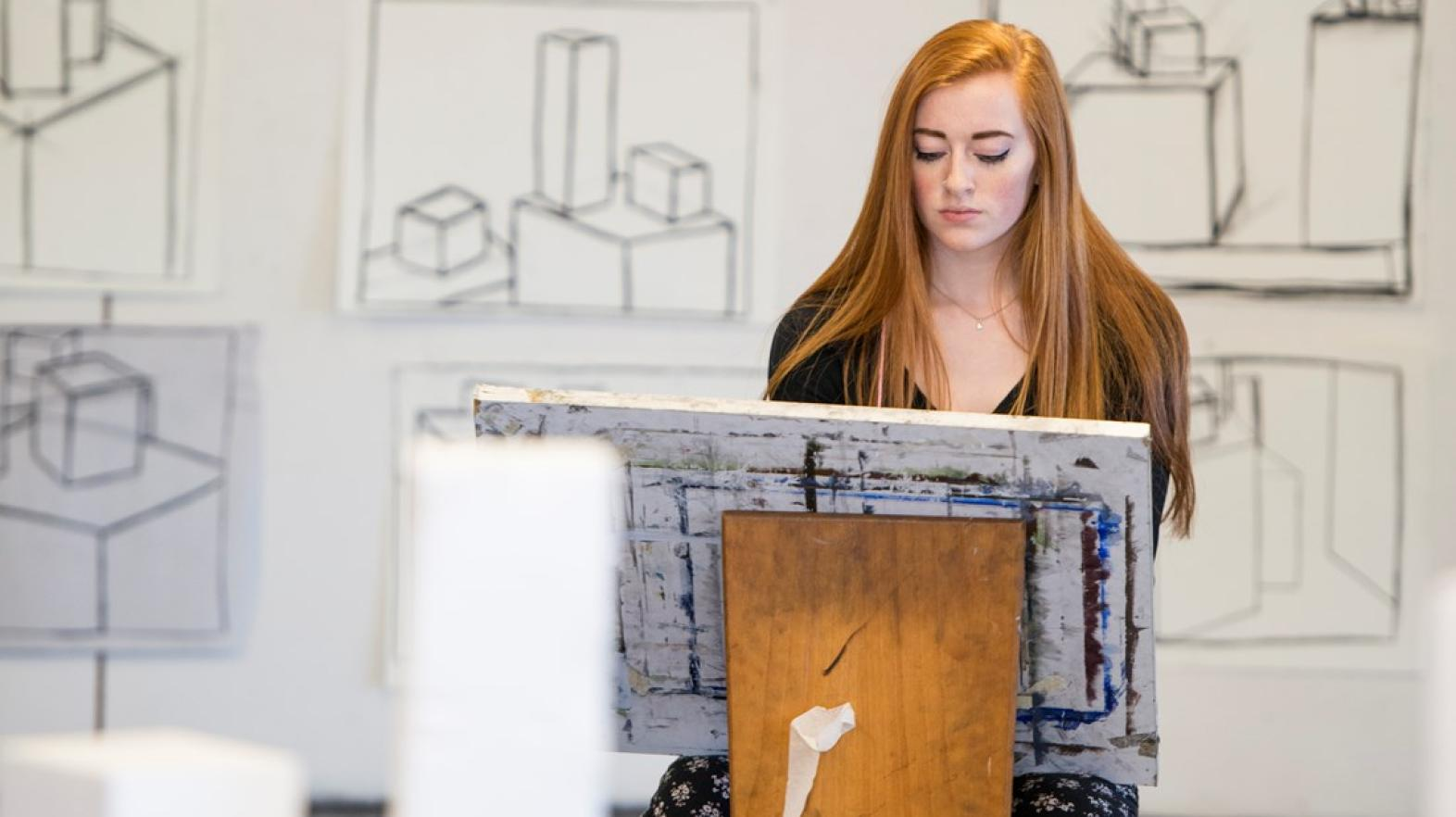 Young woman uses art studio space to create art