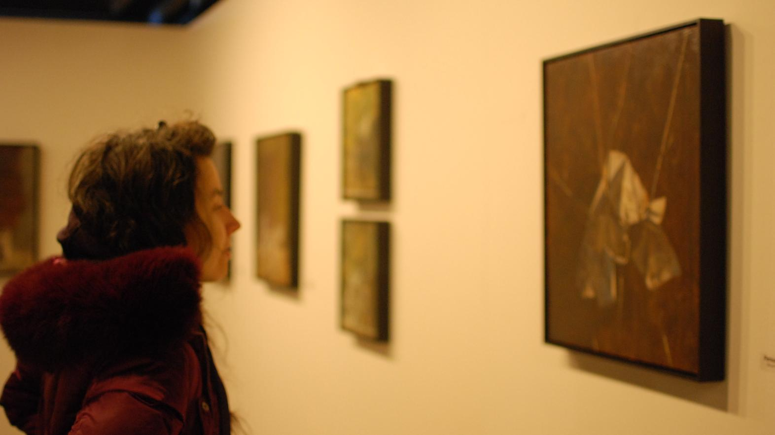 Student admires art in the William Blizard Gallery