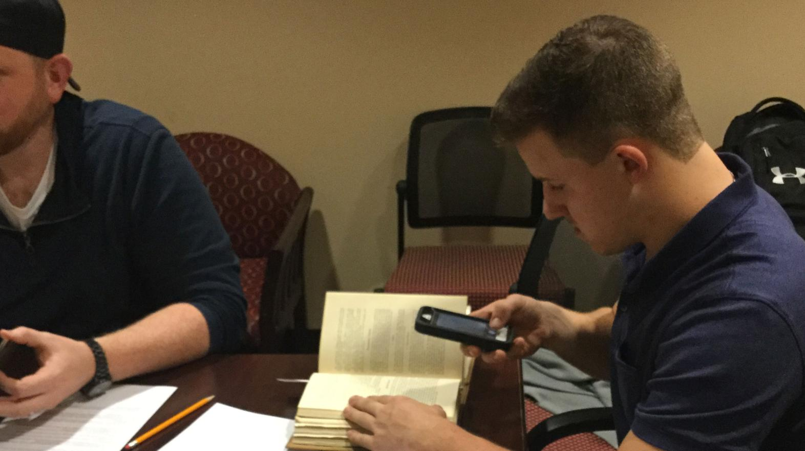 An American studies major does research in the archives for a project on Springfield College.