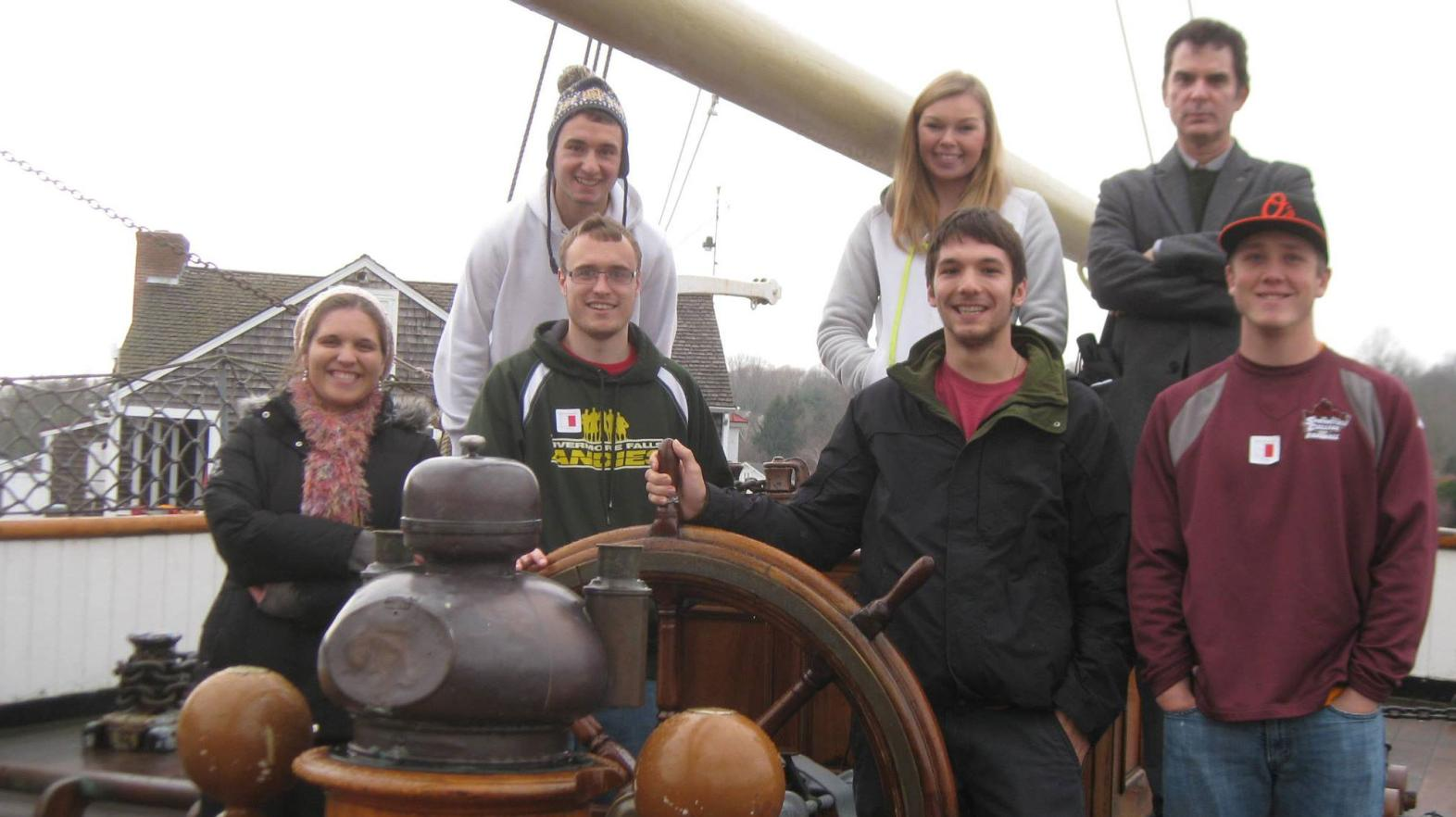 Students pose during a field trip to Mystic Seaport where at Springfield College alumna is employed.