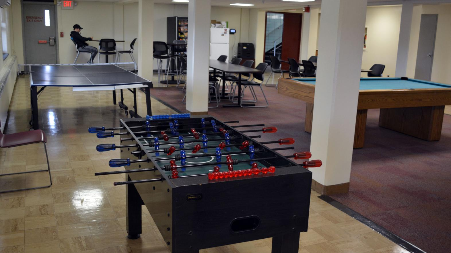A foosball and ping pong table are included in the common area of Massasoit residence hall.
