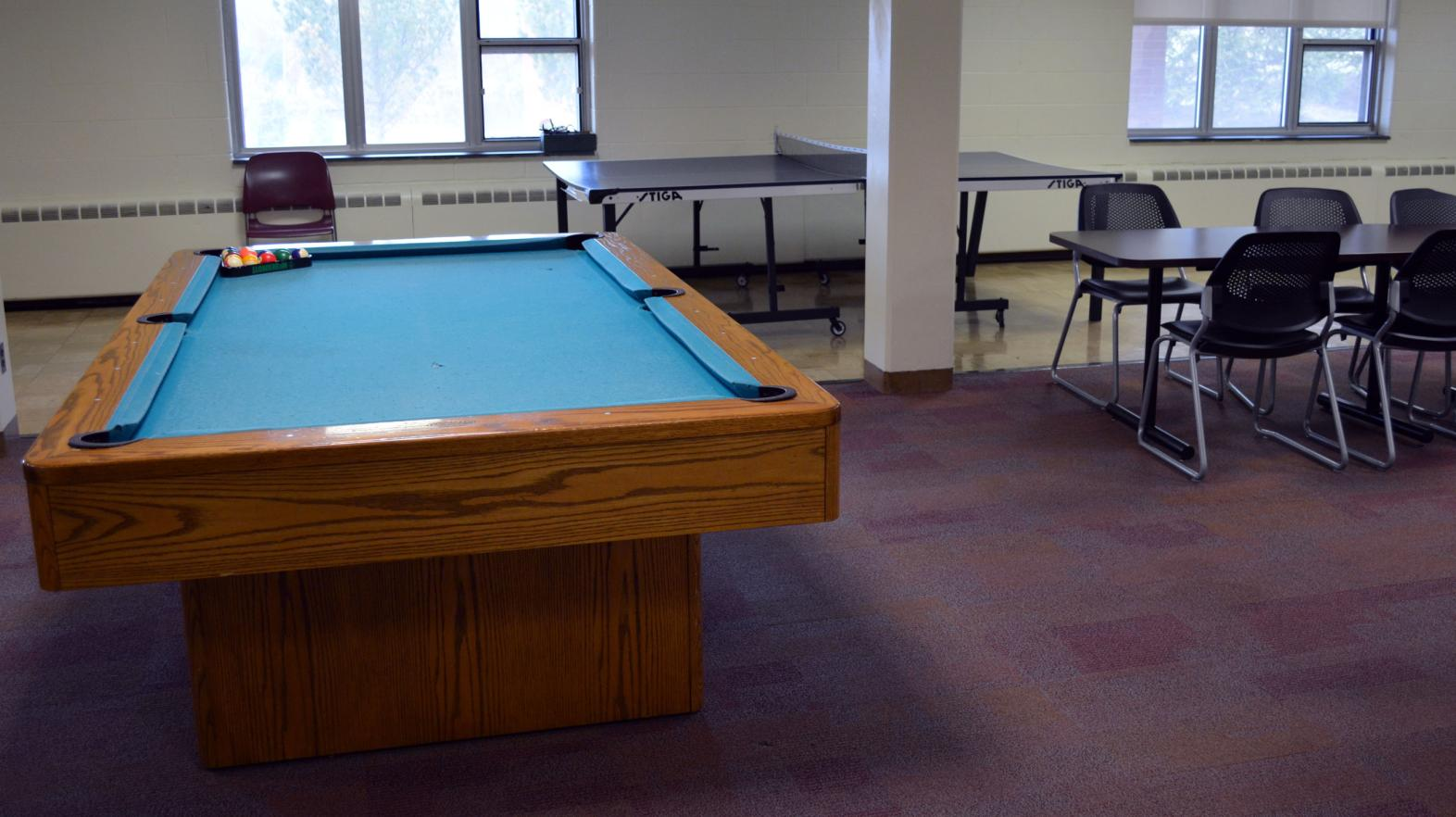A pool table is included in the basement lounge of Massasoit hall.