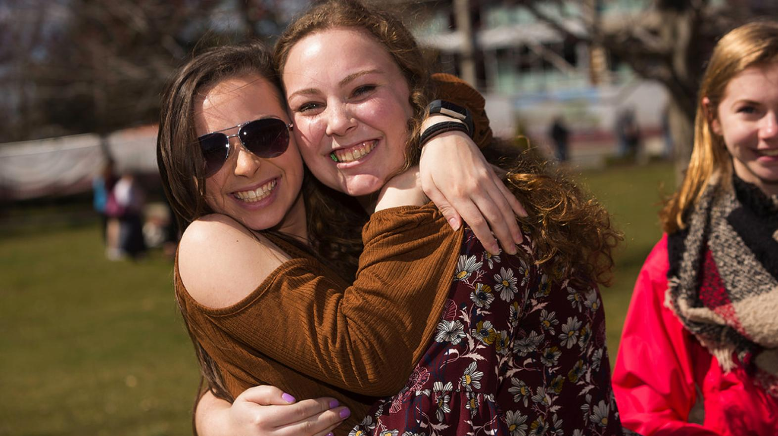 Friends hugging at Springfield College