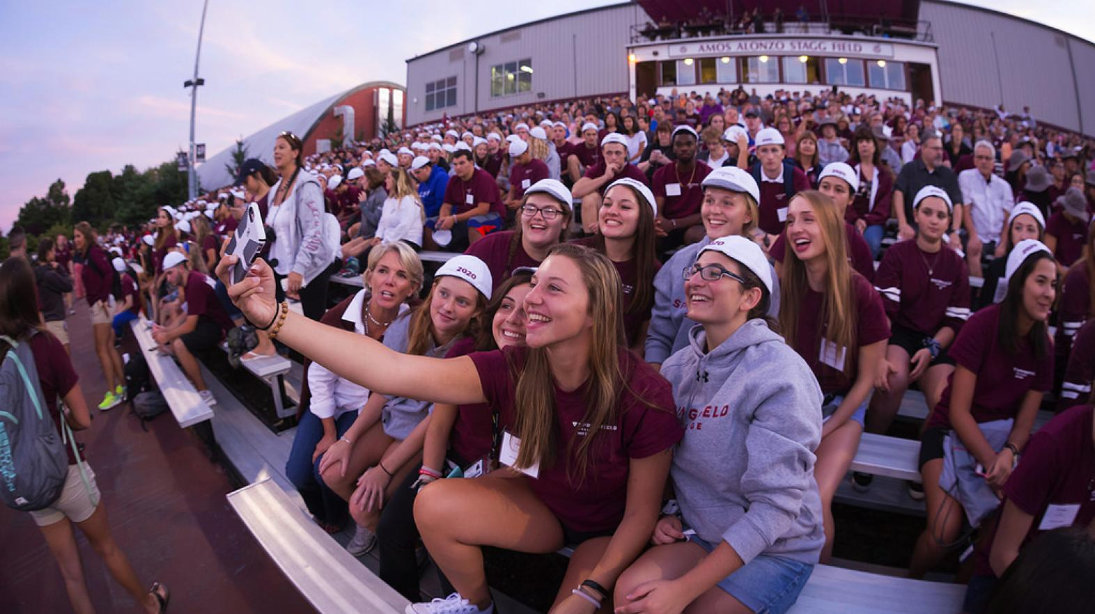 Students take a selfie at a Springfield College football game
