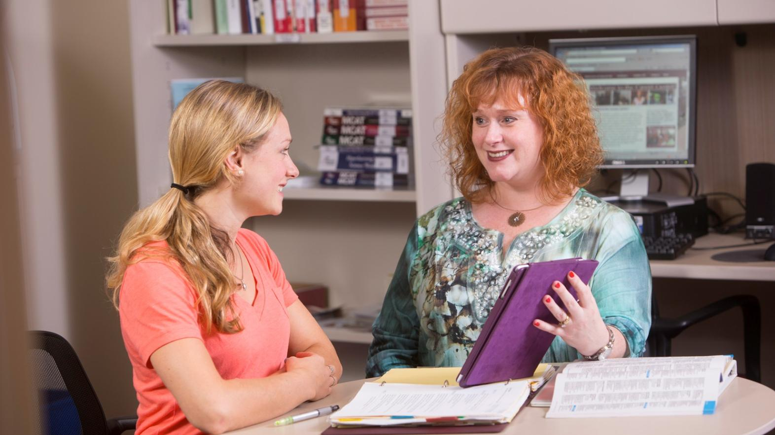 A career counselor works with a student at the Career Center at Springfield College