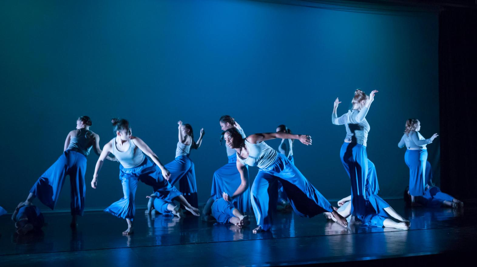 Springfield College dancers performing on stage.