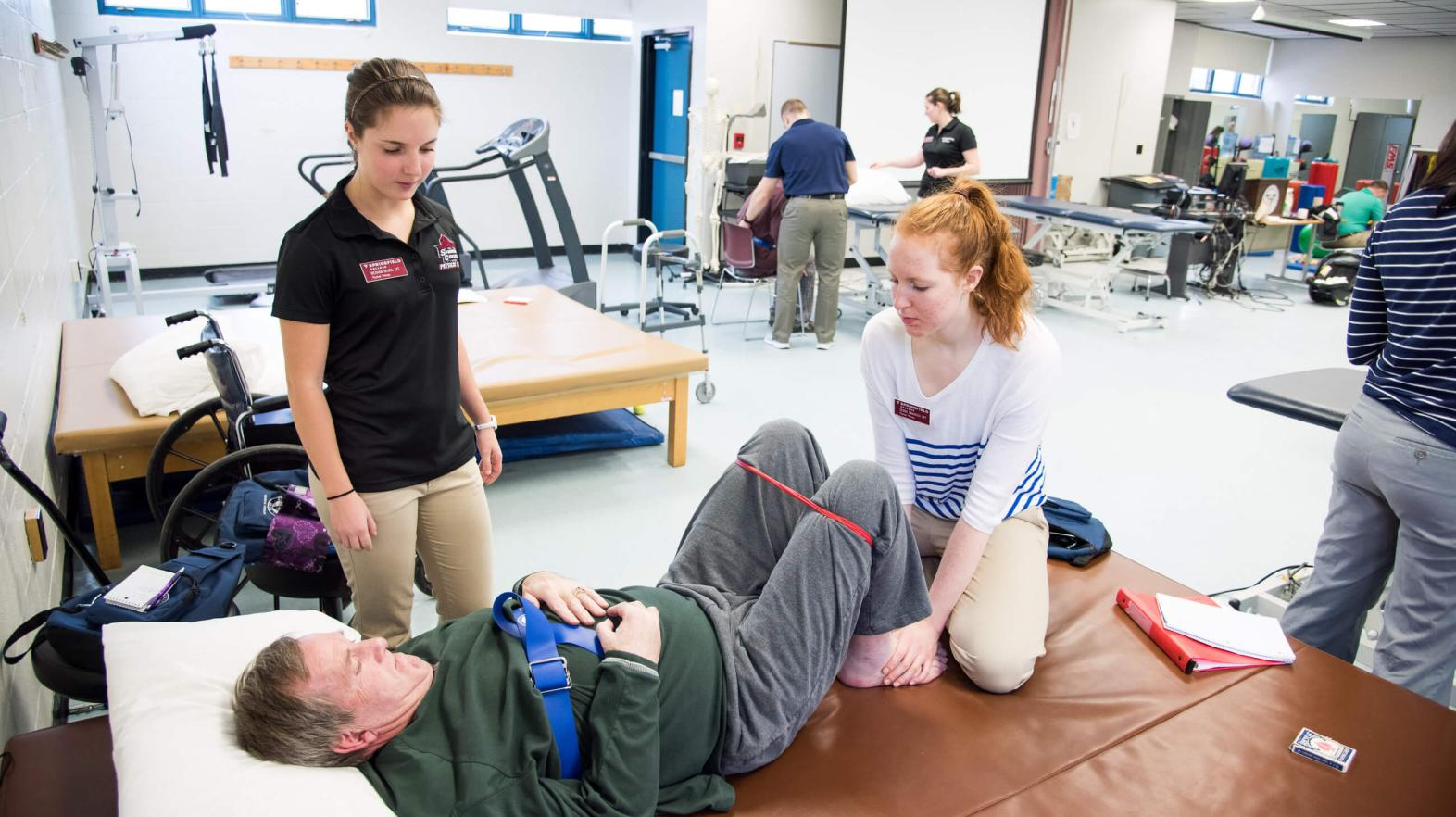 Students work with patients in the stroke clinic on campus.