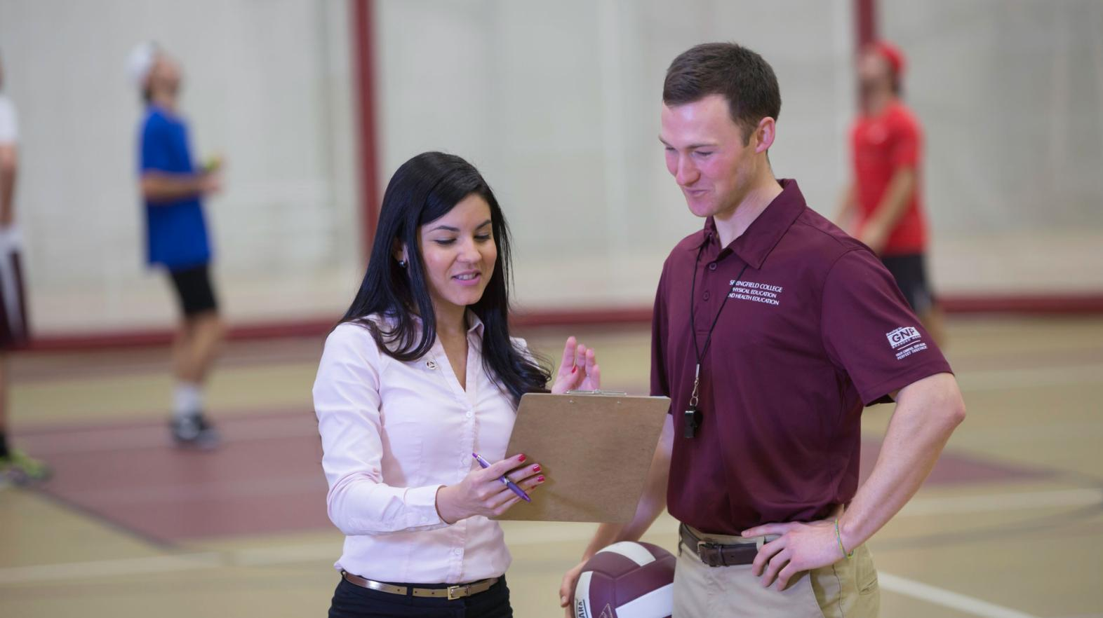 A physical education student works with a client at Springfield College