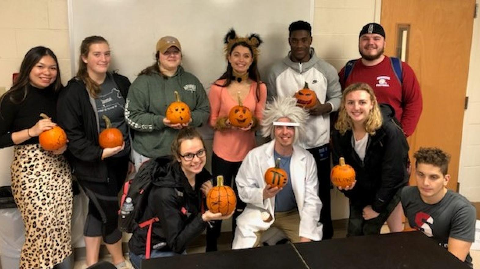 Students in the Department of Mathematics, Physics, and Computer Science participate in a Pumpkin contest at Halloween