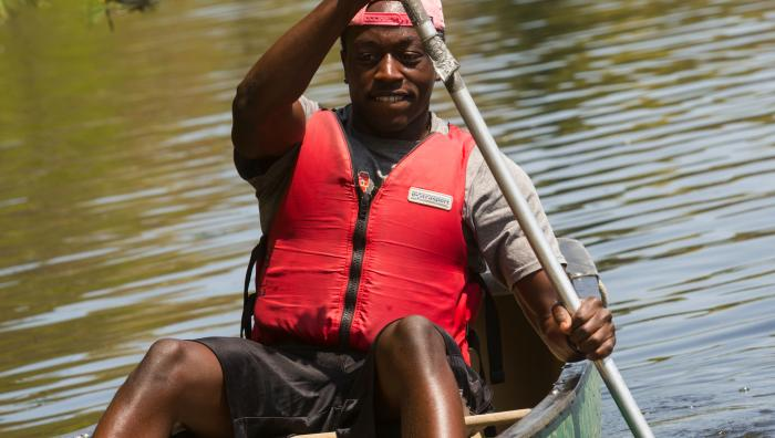 Student canoeing at East Campus