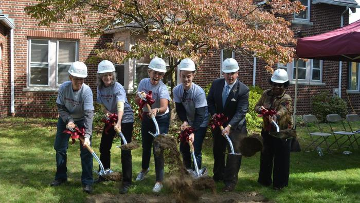 President Mary-Beth Cooper leads a groundbreaking ceremony for the new community center