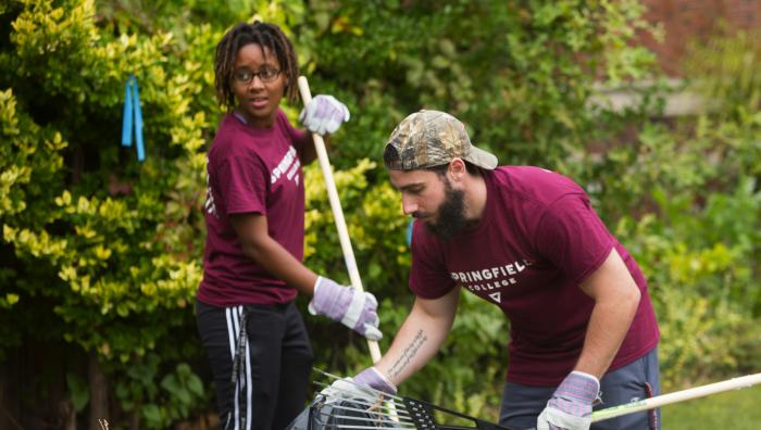 Two students raking leaves during Humanics in Action Day 2016