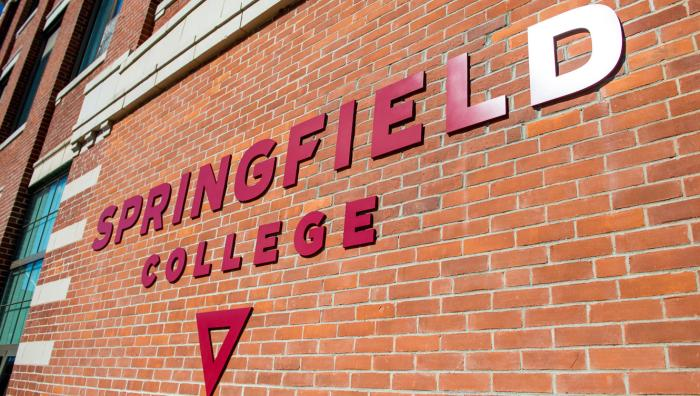 The Springfield College logo on the side of Locklin Hall.