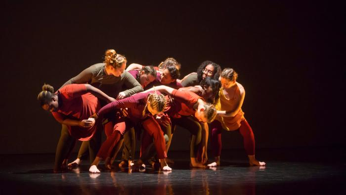 Springfield College Dancers perform a piece where they fall into each other in a clump