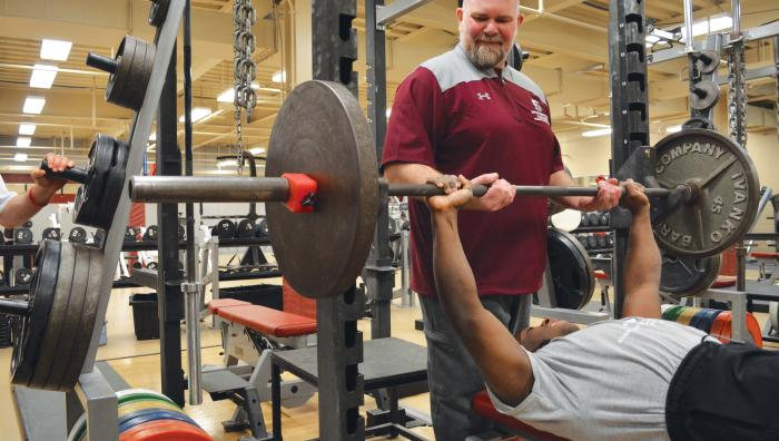 Brian Thompson, PhD, director of strength and conditioning in weight room