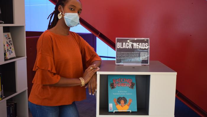 "The display included Springfield College Community Director for International Hall Sheona Douglas' children's book on display, ""Backyard Bashment."""